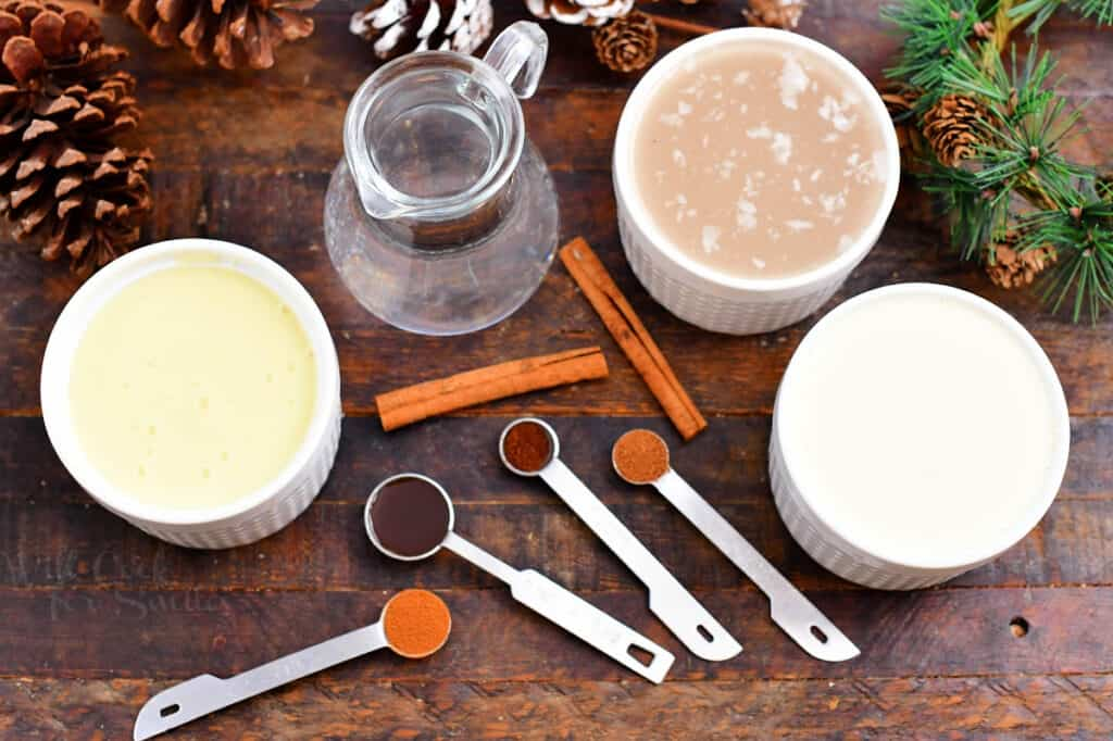 ingredients in bowls and measuring spoons to make a coquito recipe