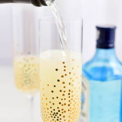 pouring champagne into a glass for a champagne cocktail