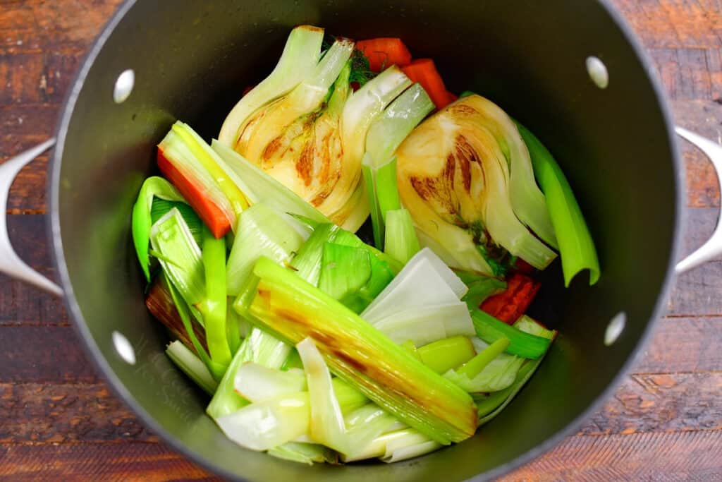 sauteed vegetables in large pot to make vegetable stock