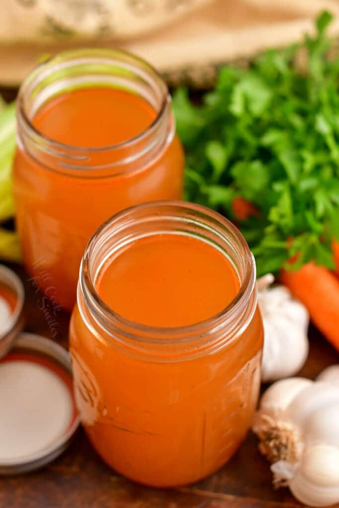 two glass jars of homemade vegetable stock