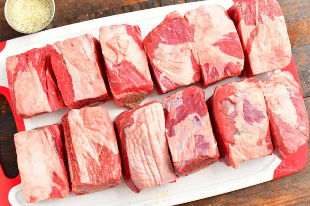 raw beef ribs on cutting board