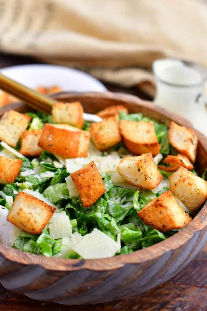 bowl of caesar salad with garlic croutons