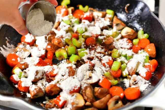 adding white flour to pan of cooked vegetables to make a roux