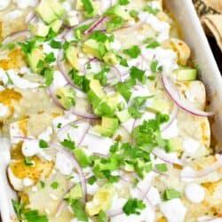 overhead: baked enchiladas verdes in a white casserole dish