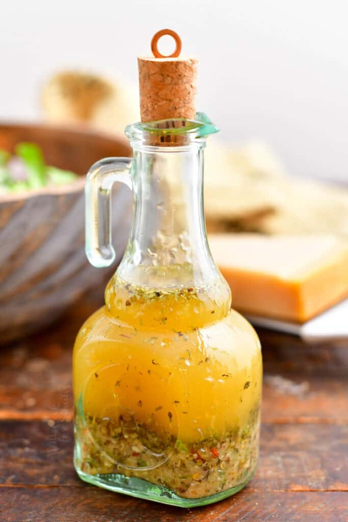 Italian vinaigrette dressing in glass bottle