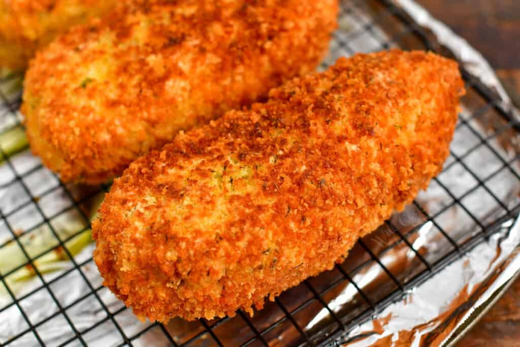 breaded and fried chicken breast on cooling rack