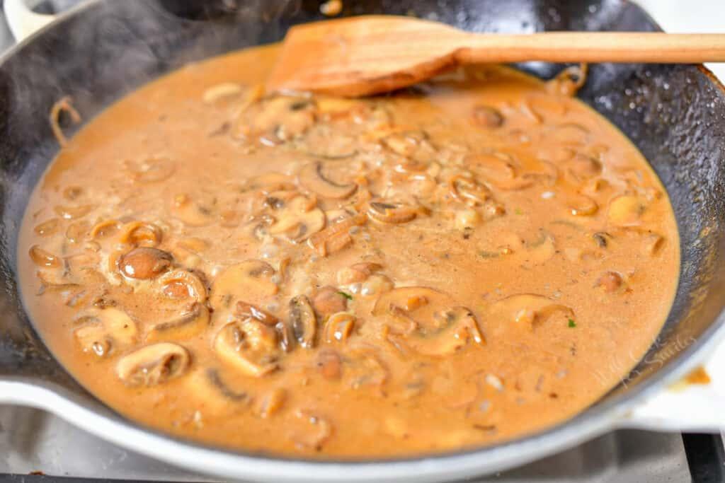 creamy mushroom sauce cooking in skillet