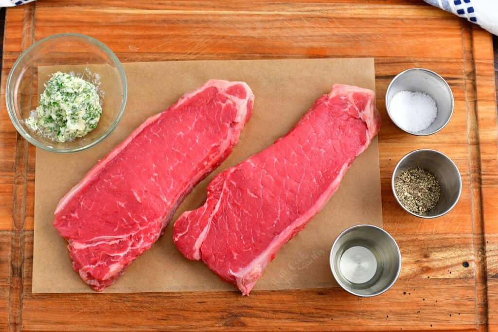 easy steak recipe ingredients: two new york strip steaks, compound butter, oil, salt and pepper