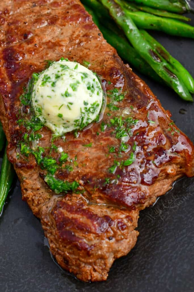 beef topped with herbed butter and roasted green beans