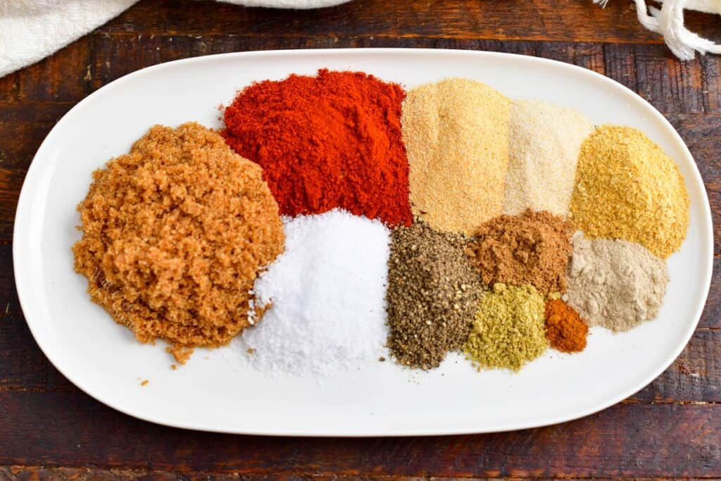 ground spices on plate to make a dry rub for pork ribs
