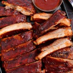 oven baked ribs with side of bbq sauce