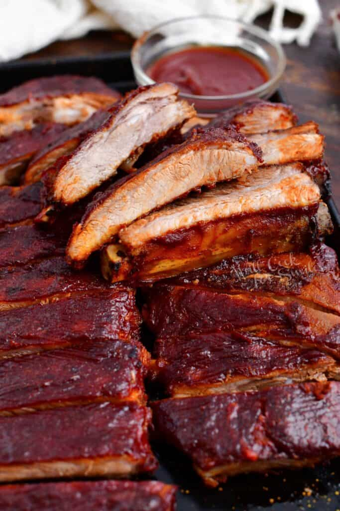 tender spare ribs on serving platter with barbecue sauce for dipping