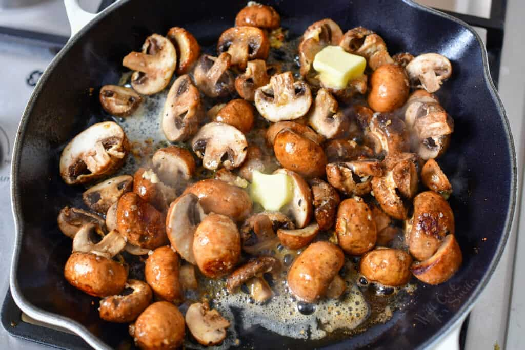 making sauteed mushrooms in a skillet of butter