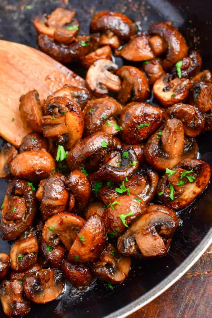 photo shows how to saute mushrooms in a skillet