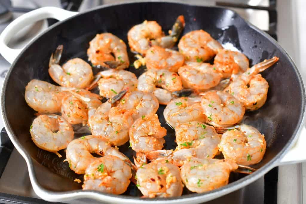 shrimp cooking in skillet with oil