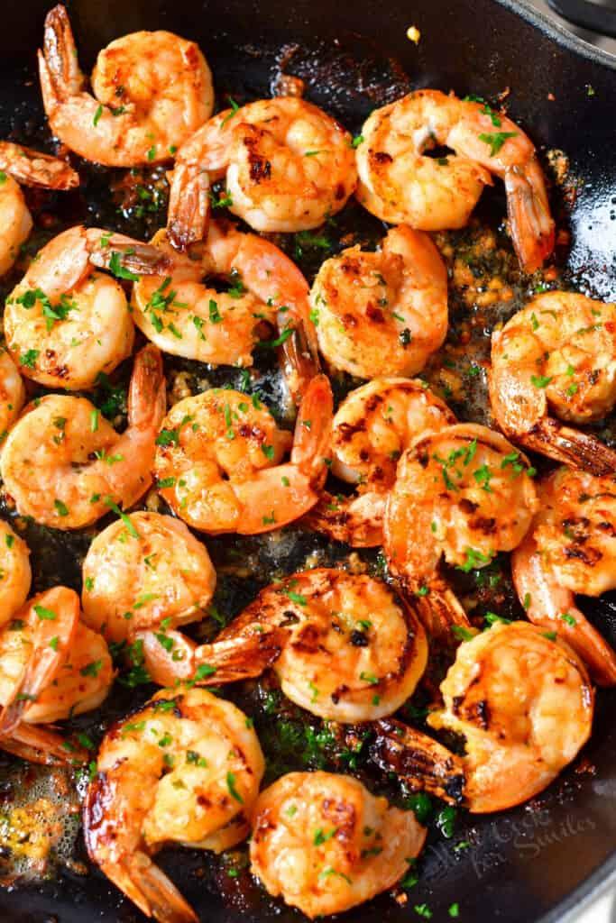 overhead image: sautéed shrimp in a pan