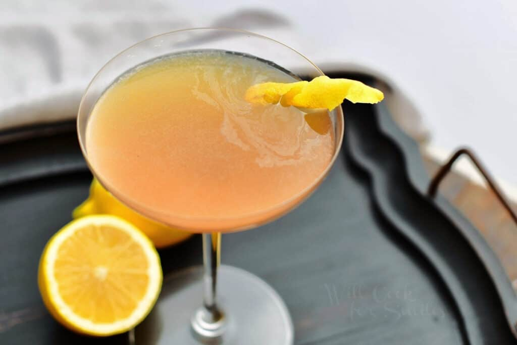 wide picture of top of the cocktail in the glass with lemon twist