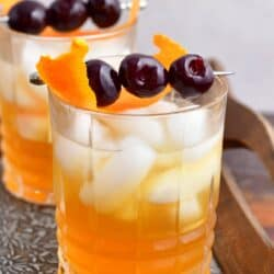 Two glasses of amaretto sour cocktail are ready to be enjoyed.
