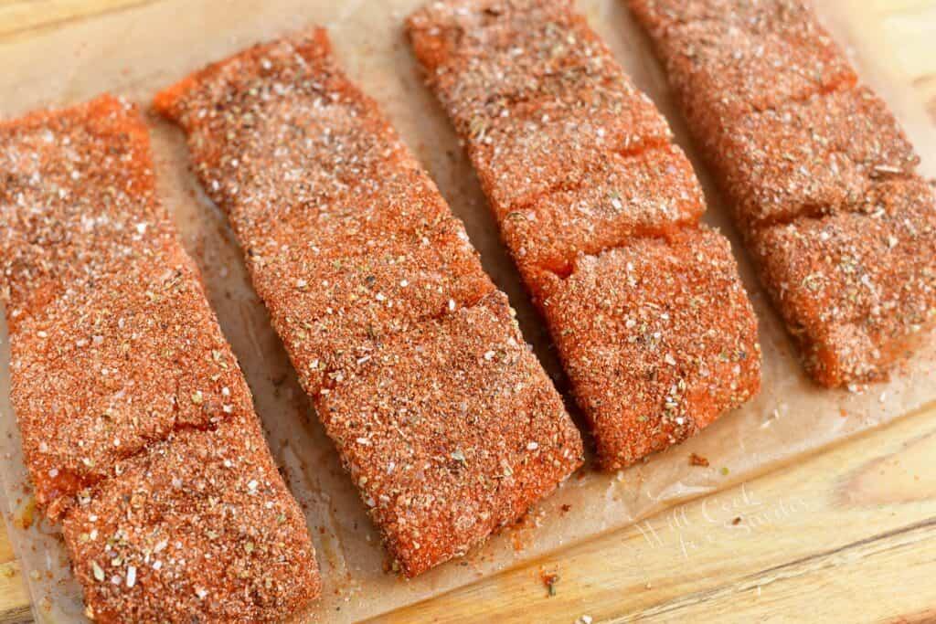 uncooked salmon fillets coated in blackening seasoning