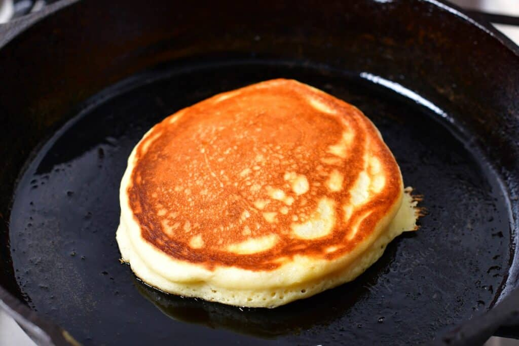 A cooked pancake is in the griddle.