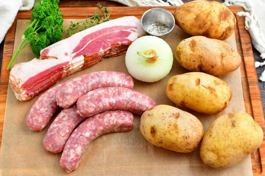 The ingredients for Dublin Coddle are placed on a wooden cutting board.