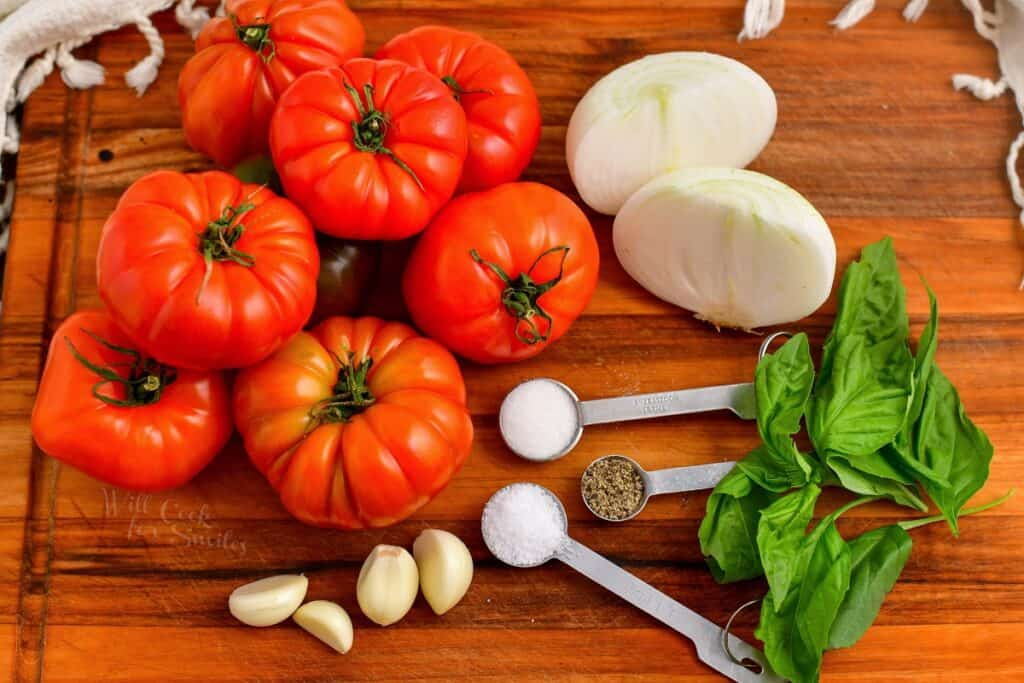 ingredients for Pomodoro sauce on a wooden cutting board
