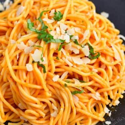 spaghetti tossed in Pomodoro sauce on a plate with Parmesan