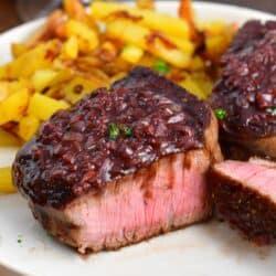 closeup of sliced tenderloin steak with sauce on top