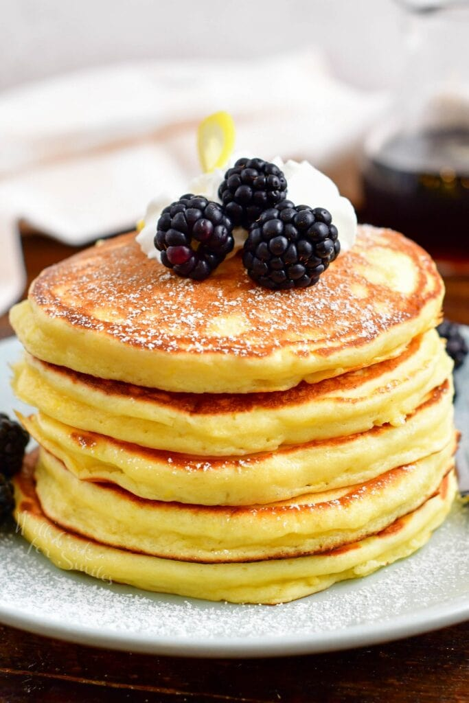 A stack of ricotta pancakes is ready to be eaten.