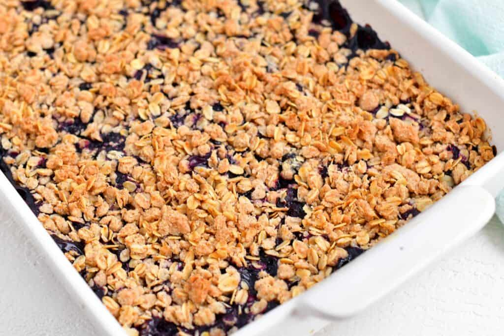 A baked blueberry crisp is fresh out of the oven.