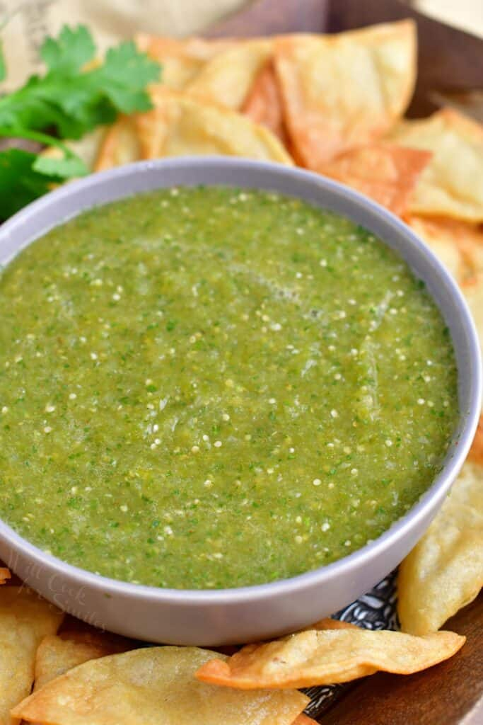 A large white bowl contains a heaping portion of salsa verde.