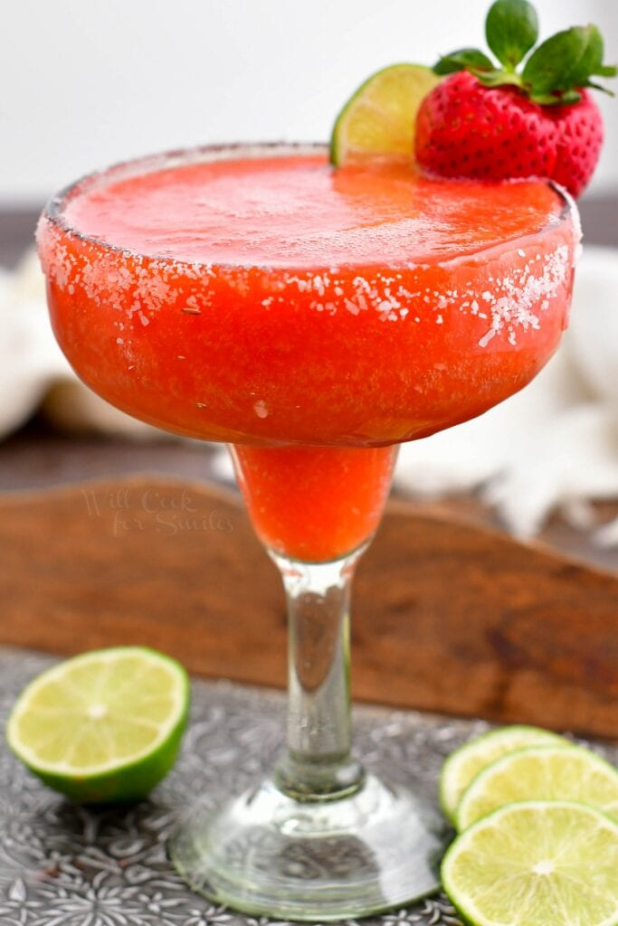 A full glass of chilled strawberry margarita is ready to be enjoyed.