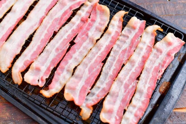 Bacon is placed on a wire rack.