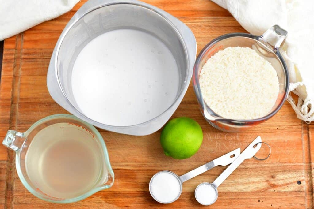 The ingredients for coconut rice are placed on a cutting board.