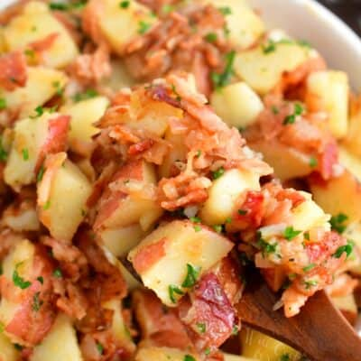 Bacon, parsley, and dressing are tossed with potatoes.
