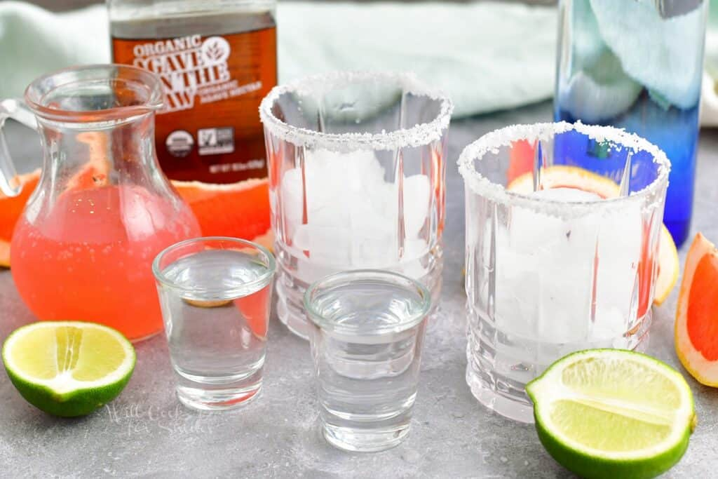 The ingredients for a paloma are placed on a kitchen counter.