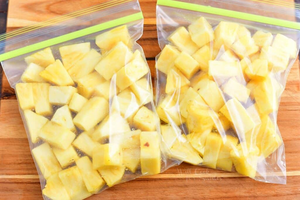 Pineapple chunks are placed in two ziplock baggies.