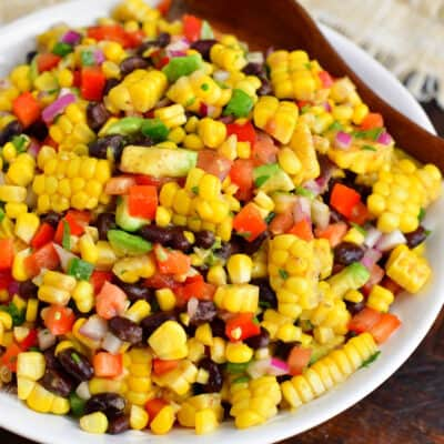 Black bean and corn salad is on a large white plate.