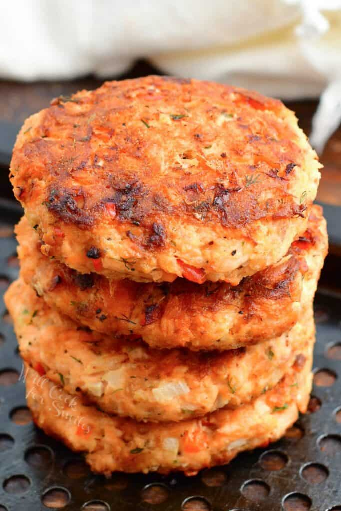 Four patties are stacked on top of one another.