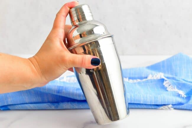 shaking the metal cocktail shaker