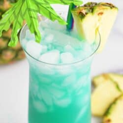 top view of blue hawaii cocktail in the glass with pineapple