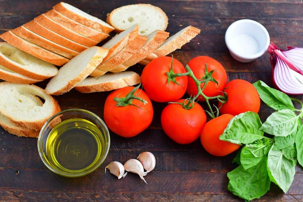 ingredients for bruschetta on a wooden surface
