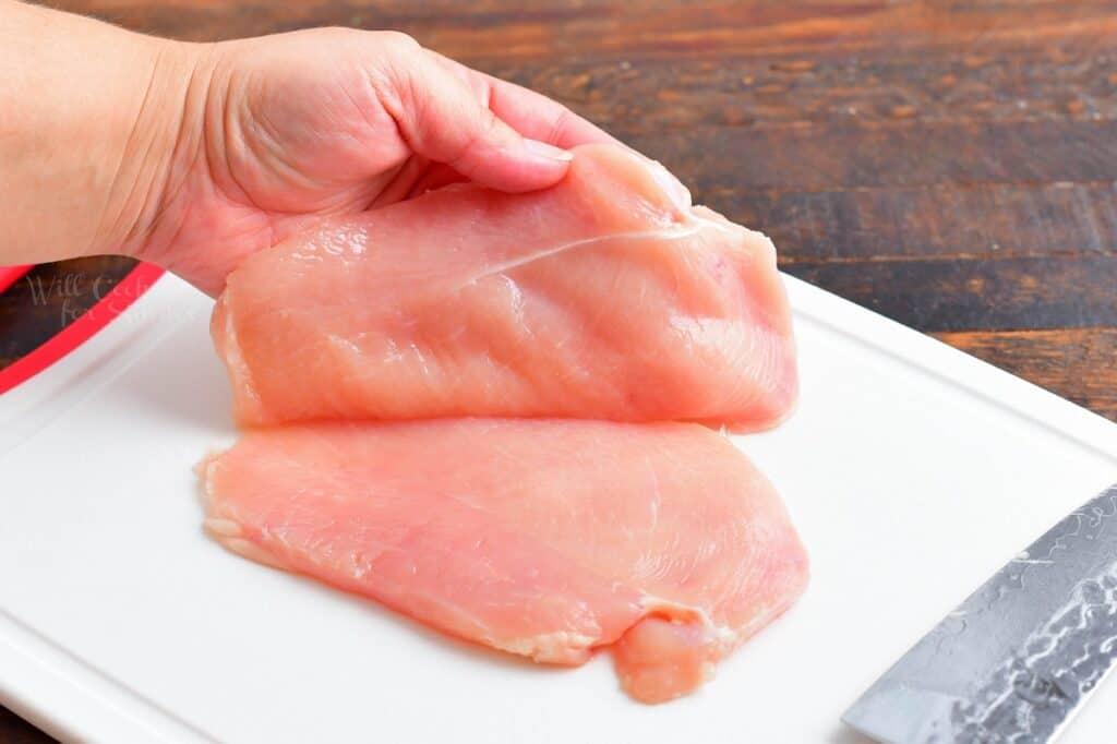 A chicken breast has been sliced in half.