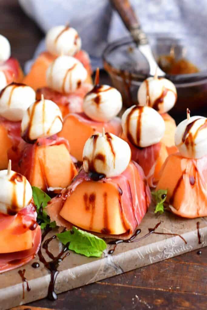 closeup of prosciutto wrapped melon appetizer