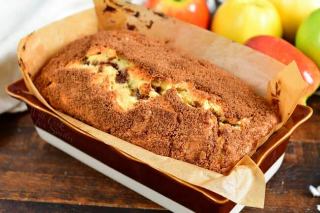 Apple bread is baked in a prepared baking dish.