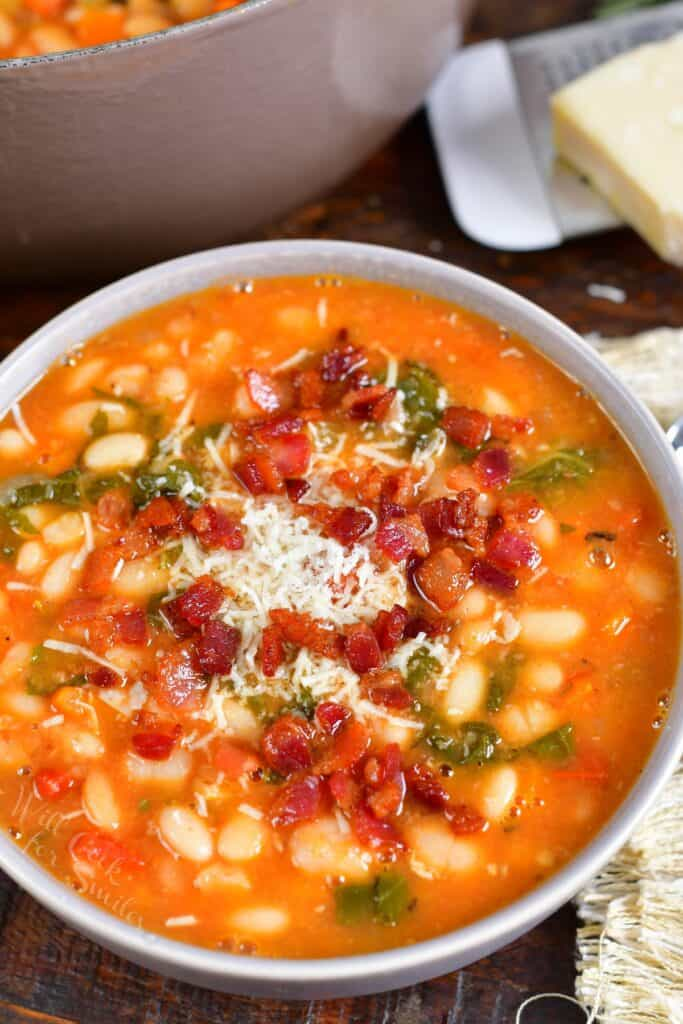 A bowl of soup is garnished and ready to eat.