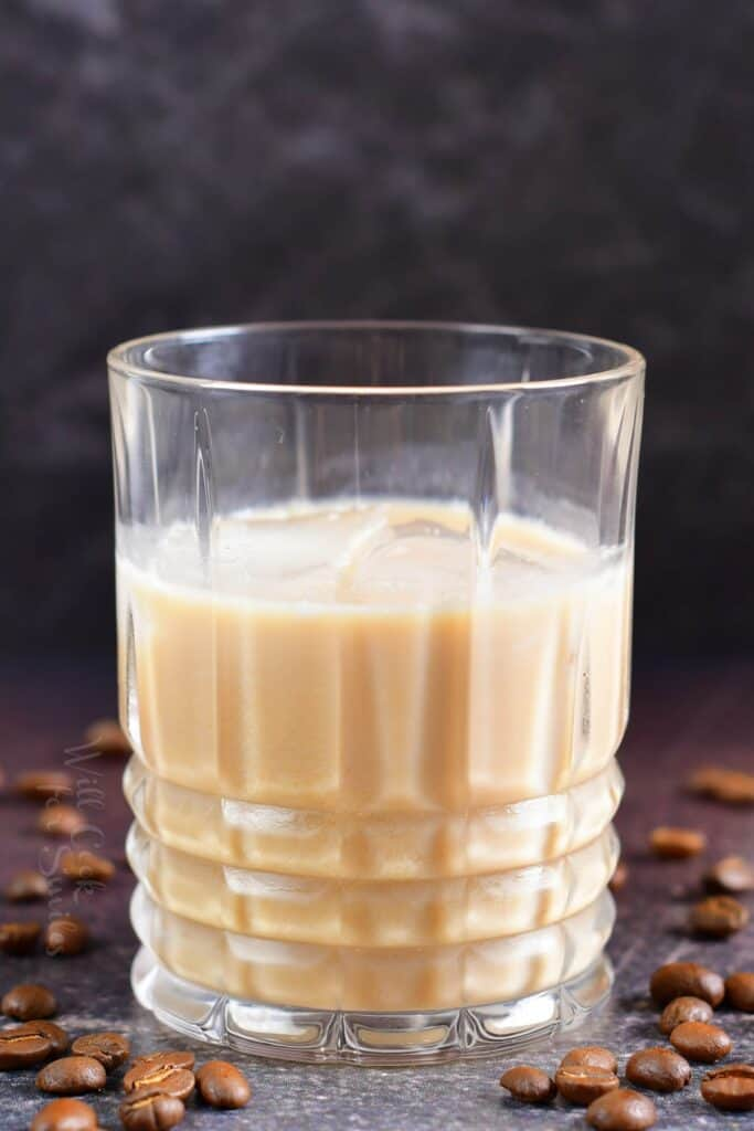 close up of creamy light brown White Russian cocktail in a glass