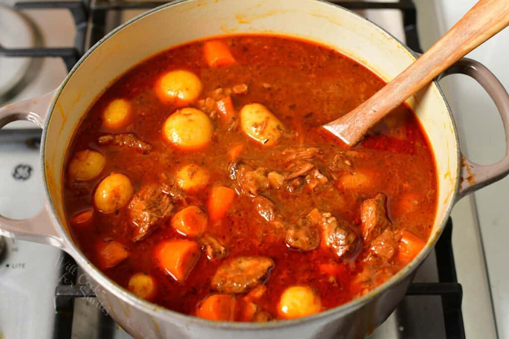 cooked beef stew in a pot on a stove