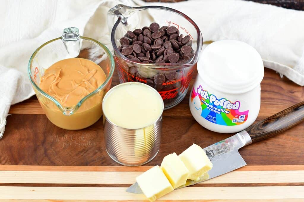 ingredients for chocolate peanut butter fudge on cutting board