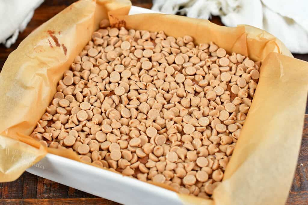 fudge topped with peanut butter chips in a baking dish